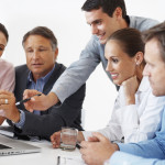 Business-People-Working-Together-iStock_000017346252Medium